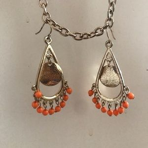 gold and orange dangle earrings